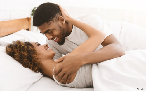 Intimate couple laying in bed